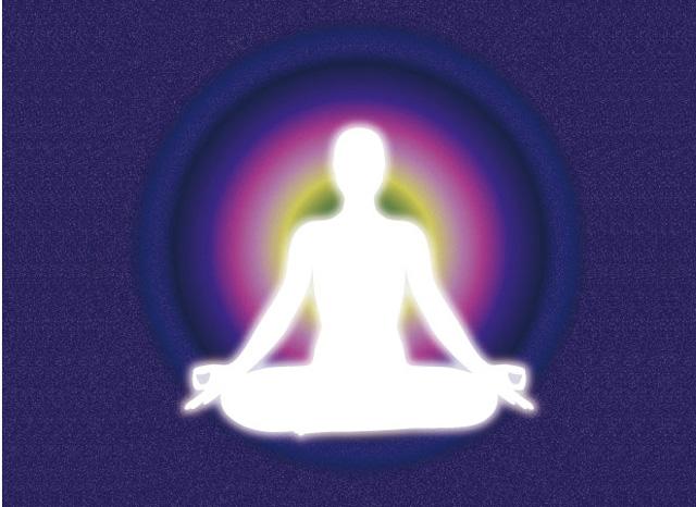 瞑想する人の周囲を取り巻く波動のイメージ