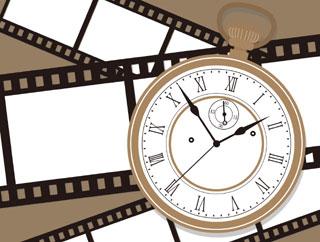 鑑定歴をイメージさせる時計と思い出フィルム